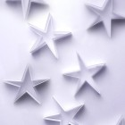 Scattered paper stars on a white background form a lovely delicate backdrop for your Christmas message